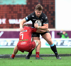 Glasgow Warriors' Oliver Kebble is tackled by Scarlets' James Davies<br /> <br /> Photographer Simon King/Replay Images<br /> <br /> Guinness PRO14 Round 19 - Scarlets v Glasgow Warriors - Saturday 7th April 2018 - Parc Y Scarlets - Llanelli<br /> <br /> World Copyright © Replay Images . All rights reserved. info@replayimages.co.uk - http://replayimages.co.uk