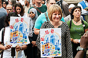 East End, London July 5th 2014. Rally and march against proposed cuts to National Health Service doctors' surgeries, specifically MPIG (Minimum Practice Income Guarantee payments) brought in to ensure practices in deprived areas had enough money to deliver high quality General Practice services. A group of activists with placards listen to speeches.