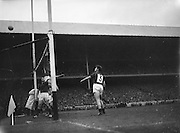 Down goalie E McKay jumps as L Murphy watches as the ball goes over the bar as Kerry get a point during the All Ireland Senior Gaelic Football Final Kerry v Down in Croke Park on the 22nd September 1960. Down 2-10 Kerry 0-8.