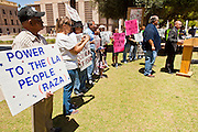 09 MAY 2011 - PHOENIX, AZ: State Senator STEVE GALLARDO, (far right) a Democrat, talks about his opposition to SB1070 and other anti-immigrant laws, while immigrants' rights supporters gather at the Arizona State Capitol in Phoenix Monday. Governor Jan Brewer, State Senate President Russell Pearce and Attorney General Tom Horne, all Republicans, held one press conference to announce that the state was suing to take its legal battle over SB1070, Arizona's tough anti-immigration law, past the US Court of Appeals and straight to the US Supreme Court. State Senator Steve Gallardo, a Democrat, held a press conference to announce that he was opposed to the Republican's legal actions and called on them to drop the suit altogether. Isolated shouting matches broke out between activists on both sides of the immigration issue during the press conferences.       Photo by Jack Kurtz