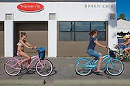 Riding bikes on the bike path between Santa Monica and Venice - Los Angeles, California.