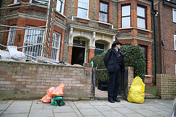 © Licensed to London News Pictures. 25/01/2020. London, UK. A police officer guards the crime scene on Mount Pleasant Road in Clapton, East London. Police launch a murder investigation at a residential property following fatal stabbing after 11pm on Friday 24 January following reports of a disturbance. A man was found with stab injuries inside the property and died later. A 27 year old man was arrested at the scene on suspicion of murder. Photo credit: Dinendra Haria/LNP