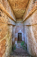 Domos (entrance corridor) to an Etruscan tumulus tomb cut into Tuff volcanic ,6th century BC,   Necropoli della Banditaccia, Cerveteri, Italy. A UNESCO World Heritage Site .<br /> <br /> Visit our ETRUSCAN PHOTO COLLECTIONS for more photos to buy as buy as wall art prints https://funkystock.photoshelter.com/gallery-collection/Pictures-Images-of-Etruscan-Historic-Sites-Art-Artefacts-Antiquities/C0000GgxRXWVMLyc