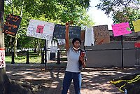"""June 12 + 13, 2020. Chelsea Enix, after painting """"Show Love"""" along H Street NW, which borders Lafayette Square and the White House. Two weeks after peaceful protesters were teargassed. the nation's capital remains on edge, those in power unwilling to confront either a racist past or an equitable future. In yellow letters 35 feet high, the street that spans two blocks between K Street NW and the White House has been renamed Black Lives Matter Plaza NW, an effort seen around the world. The area has become a pilgrimage spot for thousands of people supporting civil rights."""