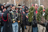 Goshen, New York - A high school ROTC member in uniform salutes during a Wreaths Across America ceremony at Orange County Veterans Memorial Cemetery on Dec. 16, 2017. About 3,000 wreaths were placed at graves, and small American flags were added to the wreaths at veterans' graves.
