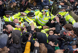 © Licensed to London News Pictures. 03/04/2021. London, UK. A police officer (2R) uses pepper spray as scuffles break out in Parliament Square during a Kill the Bill demonstration in central London. A coalition of groups including Extinction Rebellion, Kill the Bill & Black Lives Matter are coming together over the Easter weekend to campaign against the proposed Police, Crime, Sentencing and Courts Bill which will give police in England and Wales more power to impose conditions on non-violent protests. Photo credit: Peter Macdiarmid/LNP