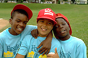 Happy inner city ball players age 10 with arms around each other.  St Paul  Minnesota USA