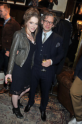 CHARLOTTE SPENCER and DEXTER FLETCHER at a reception hosted by Ralph Lauren Double RL and Dexter Fletcher before a private screening of Wild Bill benefitting FilmAid held at RRL 16 Mount Street, London on 26th March 2012.