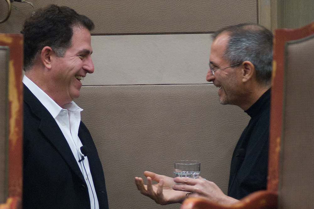 Dell Chairman and CEO Michael Dell (L) and Apple CEO Steve Jobs visit before their panel discussion at the Texas Public Education Reform Foundation conference in Austin, Texas, February 16, 2006.  The two business leaders spoke the the attendees about technology and education.