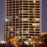 Vertical photo of One Park Place condominium tower, formerly the BMA Building, designed by Skidmore Owings Merrill Architects. Kansas City, Missouri at dusk.