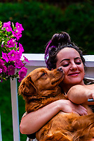 Young woman with her Australian Shepherd/Golden Retriever mix dog, Littleton, Colorado USA.