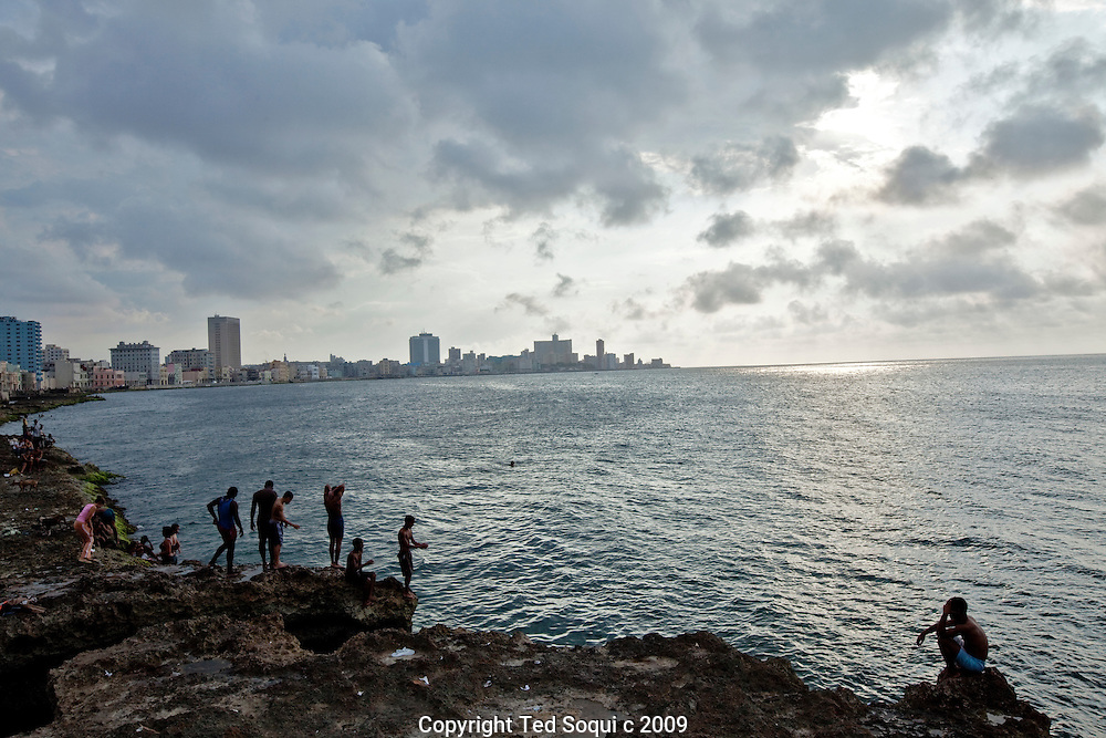 Children diving off of the Malecon sea wall in Havana.