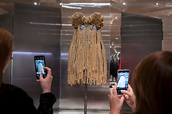 "© Licensed to London News Pictures. 09/05/2018. LONDON, UK.  Visitors take a photo at the preview of ""Azzedine Alaïa:  The Couturier"", the first UK exhibition of Azzedine Alaïa examining the work of one of the most respected fashion designers in history.  Over 60 rare and iconic garments are on display alongside a series of specially commissioned pieces.  The exhibition runs 10 May to 7 October 2018 at the Design Museum.  Photo credit: Stephen Chung/LNP"
