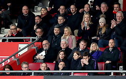 Tottenham Hotspur manager Mauricio Pochettino (bottom row right) on his phone during the Premier League match at St Mary's Stadium, Southampton.