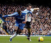 Photo: Ed Godden.<br />Chelsea v Fulham. The Barclays Premiership. 30/12/2006.<br />Chelsea's Geremi (L), is held off the ball by Tomasz Radzinski.