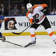 Luke Schenn, (right), Philadelphia, Flyers, in action during the New York Rangers Vs Philadelphia Flyers, NHL regular season game at Madison Square Garden, New York, USA. 26th March 2014. Photo Tim Clayton