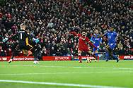 Mohamed Salah of Liverpool shoots past Leicester goalkeeper Kasper Schmeichel and scores his teams 2nd goal to make it 2-1 .Premier League match, Liverpool v Leicester City at the Anfield stadium in Liverpool, Merseyside on Saturday 30th December 2017.<br /> pic by Chris Stading, Andrew Orchard sports photography.