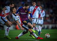 Messi of Barcelona (right) tries to overcome Velazquez of Rayo Vallecano (left) during the Spanish league football match of 'La Liga'  FC BARCELONA against RAYO VALLECANO at Camp Nou Stadium of Barcelona on March 9,2019