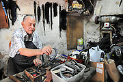A shoemaker in his workshop
