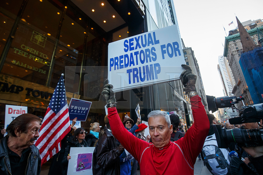 © Licensed to London News Pictures. 07/11/2016. New York CIty, USA. Anti-Trump and pro-Trump activists campaign outside Trump Tower in New York City on Monday, 7 November, the day before the presidential election day in the United States of America. Photo credit: Tolga Akmen/LNP