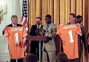 President Bill Clinton and Vice President Al Gore hold up jerseys presented by team captain Tee Martin, center, as they welcome the NCAA Men's Football Champions from the University of Tennessee during an East Room ceremony at the White House August 17, 1999.