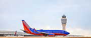 A Southwest Airlines jet about to depart from Atlanta's Hartsfield-Jackson International Airport.  <br /> <br /> Created by aviation photographer John Slemp of Aerographs Aviation Photography. Clients include Goodyear Aviation Tires, Phillips 66 Aviation Fuels, Smithsonian Air & Space magazine, and The Lindbergh Foundation.  Specialising in high end commercial aviation photography and the supply of aviation stock photography for advertising, corporate, and editorial use.