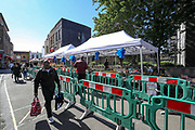 """General view of """"East Street Market"""" in Walworth, South London, where people are seen using mostly vouchers to buy groceries on Tuesday, May 5, 2020.<br /> Under a government scheme, families in need in England should receive vouchers worth £15 a week per child. Whilst a few European countries relax the COVID-19 lockdown, Britain still remains under lockdown without an exit strategy yet. (Photo/Vudi Xhymshiti)"""