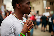 A black man listens during a protest against the KKK. Hundreds of counter protesters, including the Nation of Islam, New Black Panthers, and Huey Newton Gun Club, American Indian Movement, and ANTIFA gathered in downtown Dayton, Ohio to protest members of the Honorable Sacred Knights - a Ku Klux Klan group from Indiana. There were no arrests, and the protests ended peacefully as hundreds of police worked to keep the event peaceful and the protesters separated. Much of downtown Dayton was shutdown, and the courthouse square, where the KKK gathered, was surrounded by fence. Members of the KKK were given a police escort to the site, where about a dozen of them gathered, and then a police escort to safety.