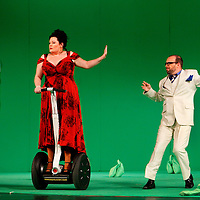 Picture shows : Karen Cargill as Isabella and  Adrian Powter as Taddeo..Picture  ©  Drew Farrell Tel : 07721 -735041..A new Scottish Opera production of  Rossini's 'The Italian Girl in Algiers' opens at The Theatre Royal Glasgow on Wednesday 21st October 2009..(Soap) opera as you've never seen it before.Tonight on Algiers.....Colin McColl's cheeky take on Rossini's comic opera is a riot of bunny girls, beach balls, and small screen heroes with big screen egos. Set in a TV studio during the filming of popular Latino soap, Algiers, the show pits Rossini's typically playful and lyrical music against the shoreline shenanigans of cast and crew. You'd think the scandal would be confined to the outrageous storylines, but there's as much action off set as there is on.....Italian bass Tiziano Bracci makes his UK debut in the role of Mustafa. Scottish mezzo-soprano Karen Cargill, who the Guardian called a 'bright star' for her performance as Rosina in Scottish Opera's 2007 production of The Barber of Seville, sings Isabella..Cast .Mustafa...Tiziano Bracci.Isabella..Karen Cargill.Lindoro...Thomas Walker.Elvira...Mary O'Sullivan.Zulma...Julia Riley.Haly...Paul Carey Jones.Taddeo...Adrian Powter..Conductors.Wyn Davies.Derek Clarke (Nov 14)..Director by Colin McColl.Set and Lighting Designer by Tony Rabbit.Costume Designer by Nic Smillie..New co-production with New Zealand Opera.Production supported by.The Scottish Opera Syndicate.Sung in Italian with English supertitles..Performances.Theatre Royal, Glasgow - October 21, 25,29,31..Eden Court, Inverness - November 7. .His Majesty's Theatre, Aberdeen  - November 14..Festival Theatre,Edinburgh - November 21, 25, 27 ...Note to Editors:  This image is free to be used editorially in the promotion of Scottish Opera. Without prejudice ALL other licences without prior consent will be deemed a breach of copyright under the 1988. Copyright Design and Patents Act  and will be subject to payment or legal action, where appropriate..Further