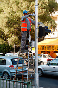 Municipality Workers Painting the traffic lights and poles, Tel Aviv, Israel November 2005
