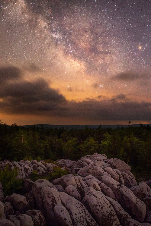 The Summer Milky Way core streams high above the ridge tops and rocky outcroppings of Dolly Sods in West Virginia.