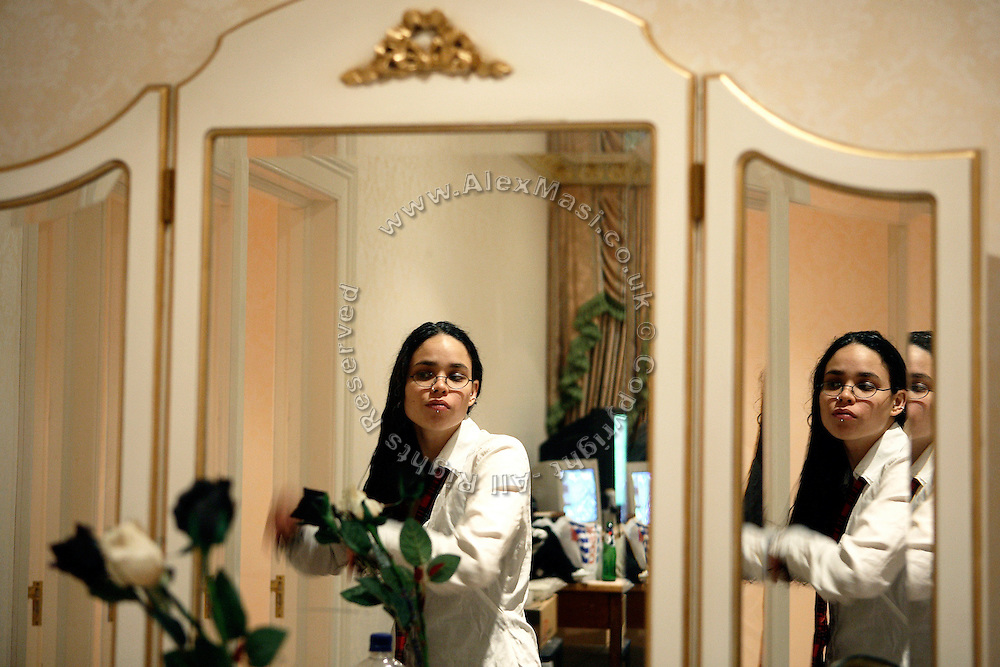 Kitty, 24, from Trinidad, is brushing her hair at the mirror in her room inside the newly squatted luxurious mansion in Winnington Road, on Saturday, Oct. 20, 2007, in Hampstead, London, England. The residence, 89 Winnington Road, was former Indonesian President Haji Mohamed Suharto's top London mansion and was sold in 1999 for UK£ 9.5M when he was being investigated in his home country in regards to his fortune and extravagant lifestyle. Million Dollar Squatters is a documentary project in the lives of a peculiar group of squatters residing in three multi-million mansions in one of the classiest residential neighbourhoods of London, Hampstead Garden. The squatters' enthusiasm, their constant efforts to look after what has become their home, their ingenuity and adventurous spirit have all inspired me throughout the days and nights spent at their side. Between the fantasy world of exclusive Britain and the reality of squatting in London, I have been a witness to their unique story. While more than 100.000 properties in London still lay empty to this day, squatting provides a valid, and lawful alternative to paying Europe's most expensive rent prices, as well as offering the challenge of an adventurous lifestyle in the capital.