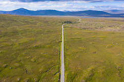 Aerial view of A82 road crossing Rannoch Moor in summer, Scotland, UK