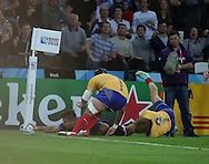 Sofiane Guitoune (France) scoring France's first try during the Rugby World Cup Pool D match between France and Romania at the Queen Elizabeth II Olympic Park, London, United Kingdom on 23 September 2015. Photo by Matthew Redman.