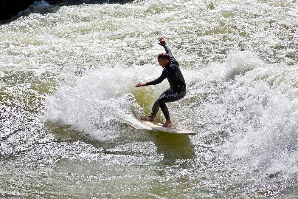 Surfer on the Hoback section of the South Fork of the Snake River surfs a rapid called Lunch Counter on an early June afternoon in Wyoming