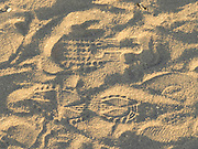 imprint of shoes in beach sand