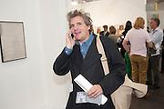 JAMES MOORES, OPENING OF FRIEZE ART FAIR. Regent's Park. London.  12 October 2011. <br /> <br />  , -DO NOT ARCHIVE-© Copyright Photograph by Dafydd Jones. 248 Clapham Rd. London SW9 0PZ. Tel 0207 820 0771. www.dafjones.com.
