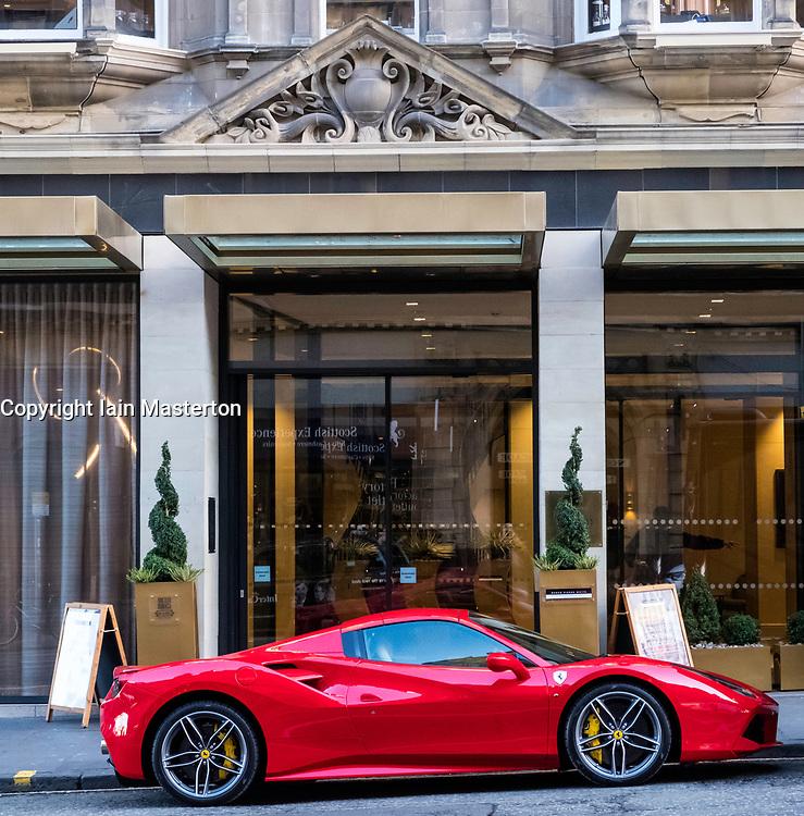 Ferrari parked outside Hilton Hotel Edinburgh in Old Town of Edinburgh, Scotland, United Kingdom