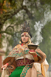 South America, Ecuador, Cuenca.  Female dancers dressed as Inca in folklore ballet troupe during annual parade and festival to celebrate founding of Cuenca in 1557.  Cuenca is a UNESCO World Heritage Site.