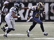 Football - NFL- Seattle Seahawks at St. Louis Rams.Seattle Seahawks cornerback Richard Sherman (25) keeps pace with St. Louis Rams wide receiver Brandon Gibson (11) who runs a pattern for a pass in the second quarter at the Edward Jones Dome in St. Louis.  The Rams defeated the Seahawks, 19-13.