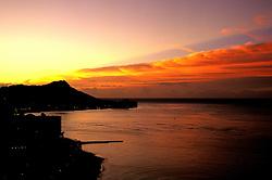 Oahu, Hawaii: Sunrise over Diamond Head and Waikiki.