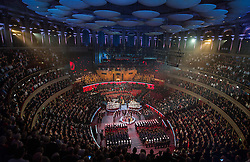 © London News Pictures. Pictured: Poppys fall from the roof of The Royal Albert Hall, London during the Festival of Remembrance on Saturday 7th November 2015. . Photo credit: Rupert Frere/LNP