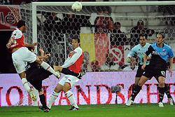 03-04-2010 VOETBAL: AZ - FC UTRECHT: ALKMAAR<br /> FC Utrecht verliest met 2-0 van AZ / Moussa Dembele scoort bijna de 3-0 maar Mark van Maarel kan nog net een voetje ervoor krijgen. Mounir El Hamdaoui, Michel Vorm en Alje Schut<br /> ©2010-WWW.FOTOHOOGENDOORN.NL