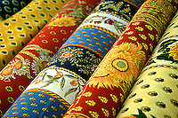 Provence Fabrics and cloths displayed, open air market, St. Tropez, France