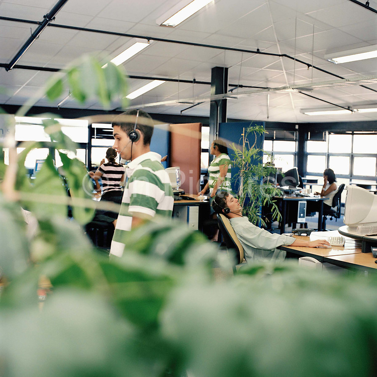 Call centre agents at work, Cape Town, South Africa. From the series Desk Job, a project which explores globalisation through office life around the World.