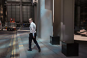 Financial industry people walk through reflected light from a nearby skyscraper in the City of London, the capitals financial district aka the Square Mile, on 15th May 2018, in London, UK.