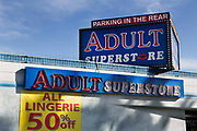 "Adult store with ""parking in the rear"", downtown Las Vegas. These type of stores are all over the city catering for the sex industry from hookers to batchelor parties and carry adult videos, magazines, lingerie, stripper shoes, fetish items, lubricants, sex toys, etc. All are open 24/7."