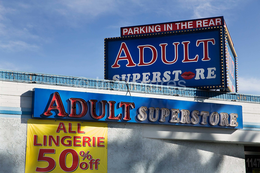 """Adult store with """"parking in the rear"""", downtown Las Vegas. These type of stores are all over the city catering for the sex industry from hookers to batchelor parties and carry adult videos, magazines, lingerie, stripper shoes, fetish items, lubricants, sex toys, etc. All are open 24/7."""