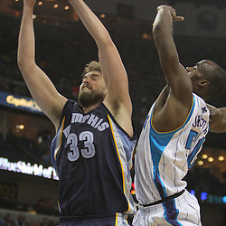 Jan 20, 2010; New Orleans, LA, USA; Memphis Grizzlies center Marc Gasol (33) grabs a rebound over New Orleans Hornets center Emeka Okafor (50)during the second half at the New Orleans Arena. The Hornets defeated the Grizzlies 113-111. Mandatory Credit: Derick E. Hingle-US PRESSWIRE