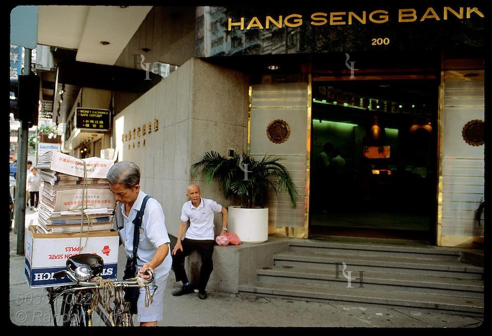 Hang Seng Bank doors slant across street corners to draw in money according to Feng Shui beliefs. Hong Kong